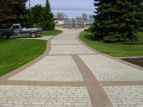 cobblestone driveway with brown brick soldiers
